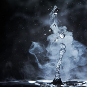 splashes of hot water on black background