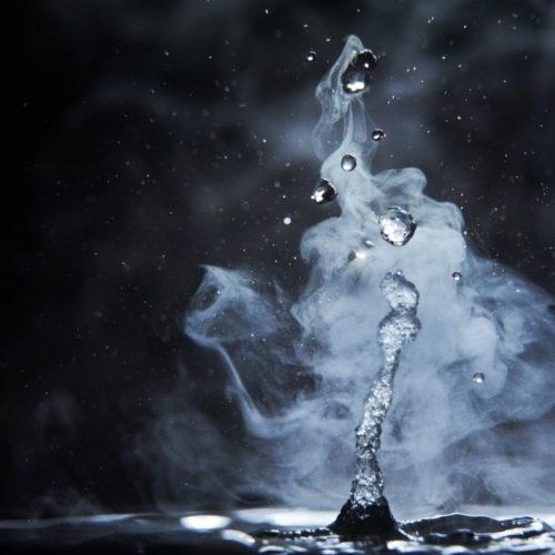 splashes of hot water on black background